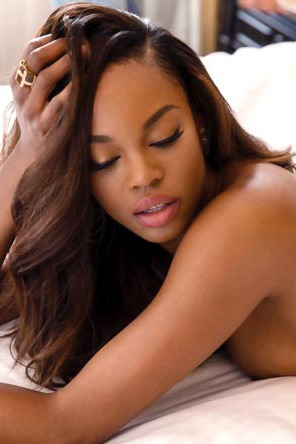 Eugena Washington Strips On A Bed