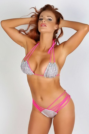 Maija Shows Off Her Perfect Curves In Her Silver And Pink String Bikini